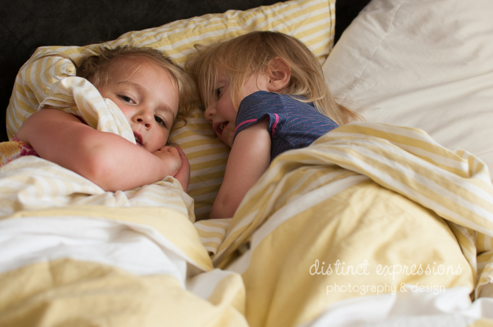 Grosse Pointe child and family photographer best friends playing in bed