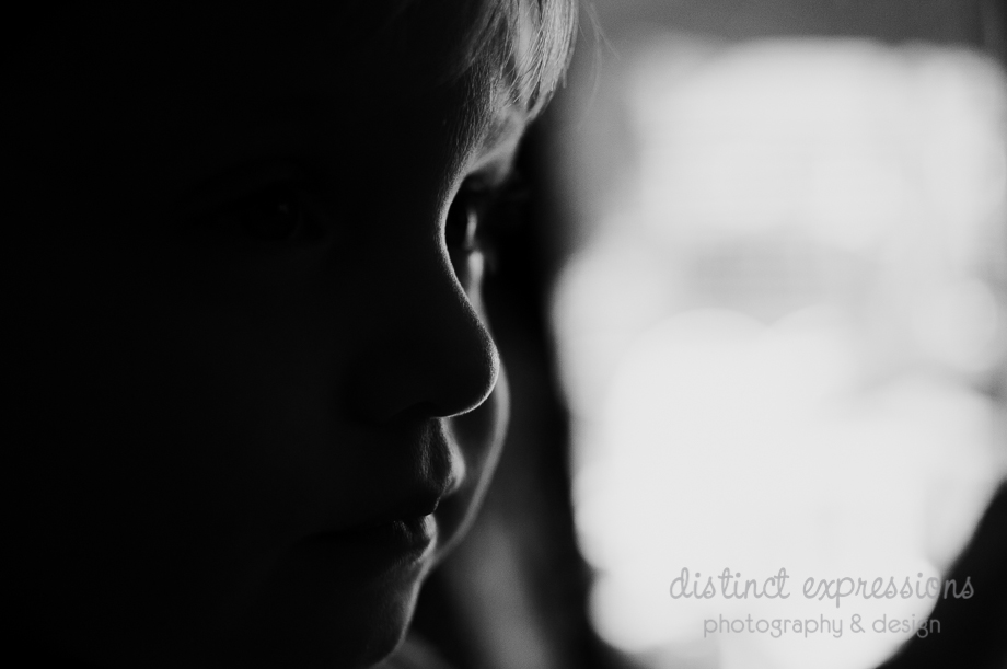 black and white photo of little girl high contrast shadows and light in grosse pointe, michigan